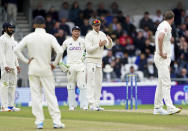 England captain Joe Root, second right, gestures to ask for a review for the wicket of India's Rohit Sharma which was turned down by the umpire due to timeout during the third day of third test cricket match between England and India, at Headingley cricket ground in Leeds, England, Friday, Aug. 27, 2021. (AP Photo/Jon Super)