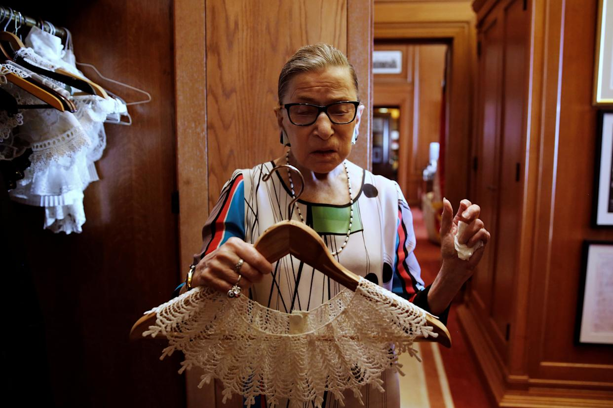 U.S. Supreme Court Justice Ruth Bader Ginsburg, in her chambers, shows the many collars (jabots) she wears with her robes.