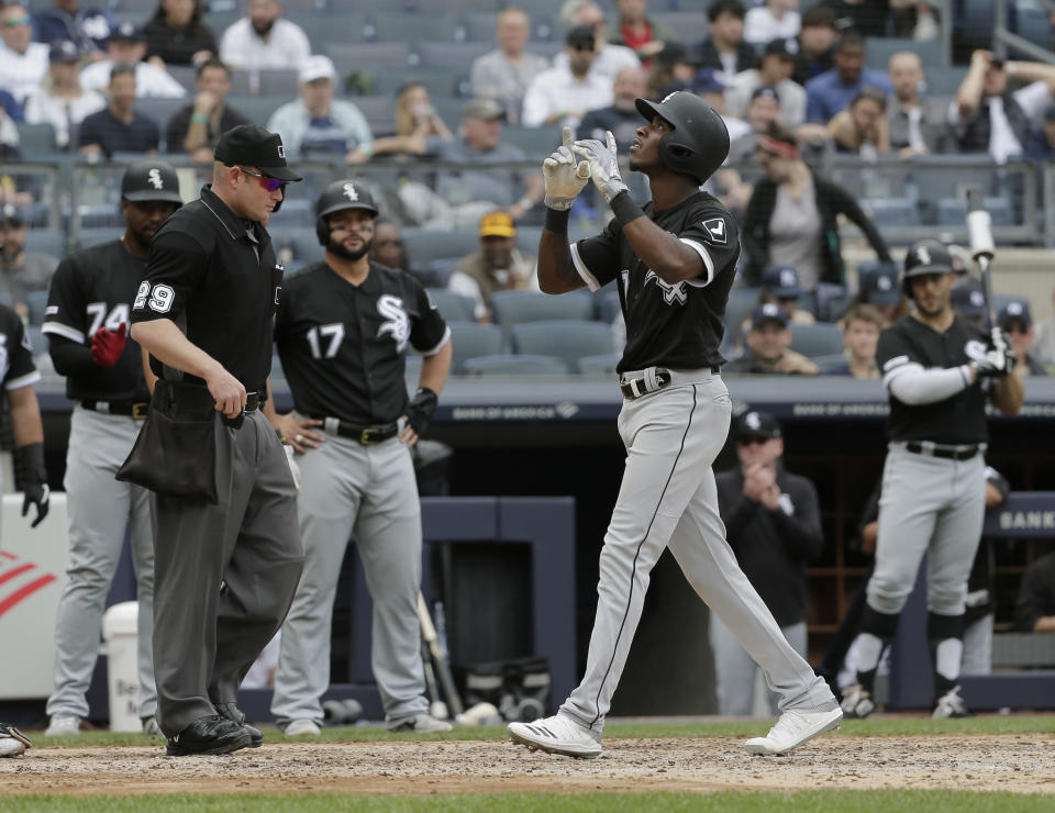 Chicago White Sox's Tim Anderson, right, reacts as he crosses home plate after hitting a grand slam during the fourth inning of a baseball game against the New York Yankees at Yankee Stadium, Sunday, April 14, 2019, in New York. (AP Photo/Seth Wenig)