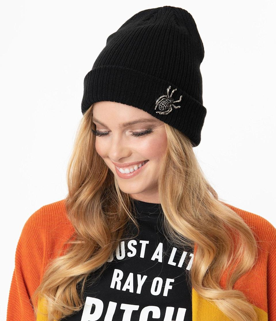 <p>Keep warm on chilly October nights with the <span>Black Rhinestone Spider Beanie Knit Hat</span> ($38).</p>