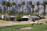 Satoshi Kodaira, center, of Japan, putts on the 17th green during the first round of The American Express golf tournament on the Nicklaus Tournament Course at PGA West, Thursday, Jan. 21, 2021, in La Quinta, Calif. (AP Photo/Marcio Jose Sanchez)