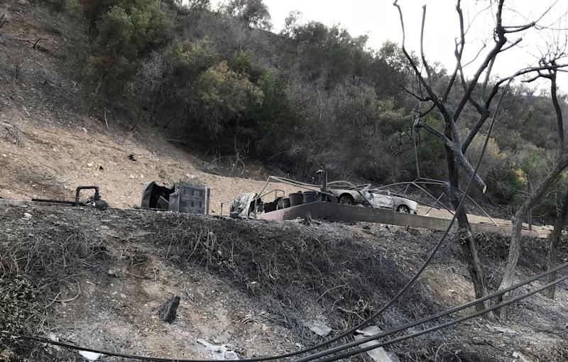A burned-out structure and car in Southern California's Ojai Valley.