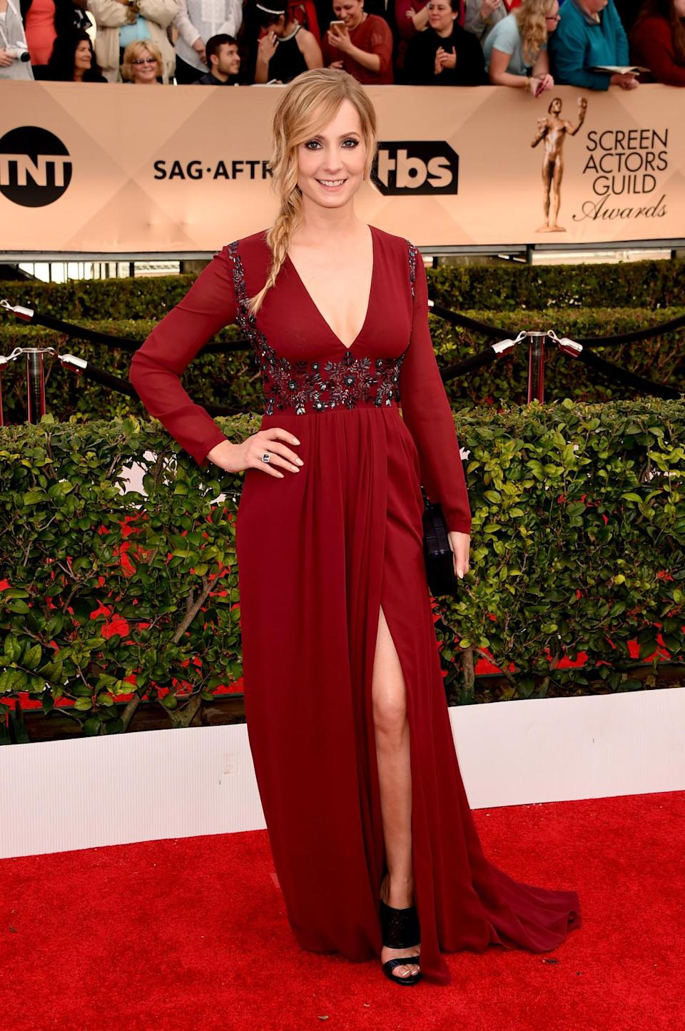 <p>Joanne Froggatt, a member of <i>Downton Abbey's </i>assembly cast, opted for a long sleeve dress in a deep red. The bodice was embellished with beading and she showed some skin with a deep V and thigh slit. <i>Photo: Getty Images</i></p>