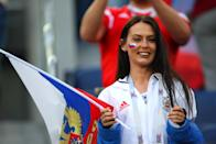 <p>A female fan of Russia looks on during the 2018 FIFA World Cup Russia group A match between Russia and Egypt at Saint Petersburg Stadium on June 19, 2018 in Saint Petersburg, Russia. (Photo by Robbie Jay Barratt – AMA/Getty Images) </p>