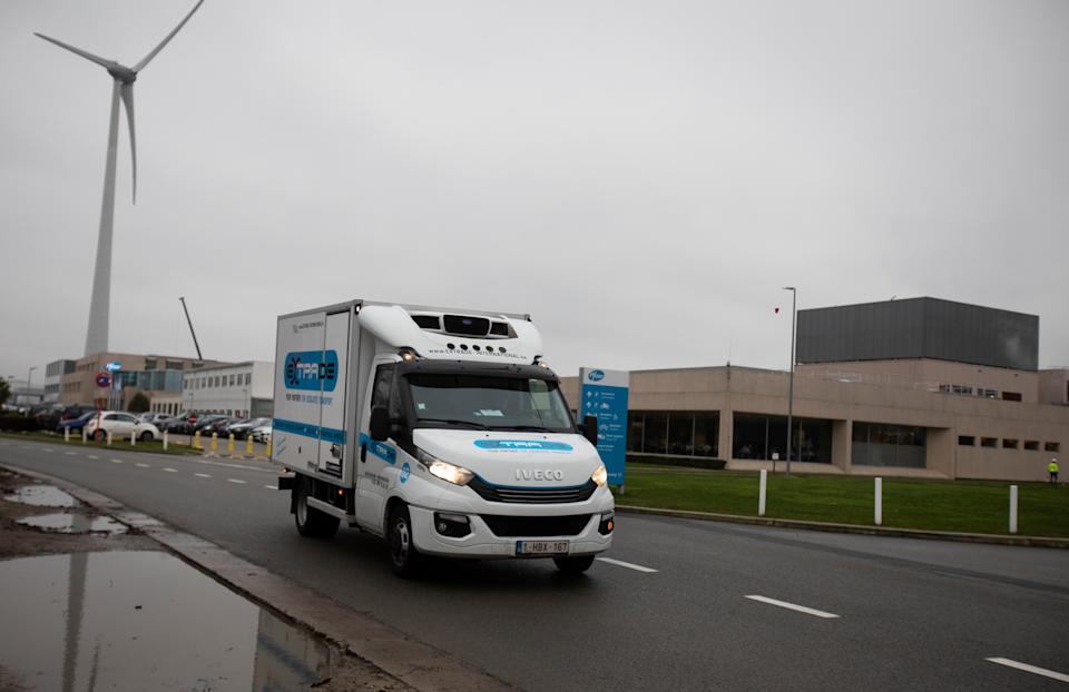 <p>A truck carrying the Pfizer vaccine seen leaving a factory in Belgium</p>AP