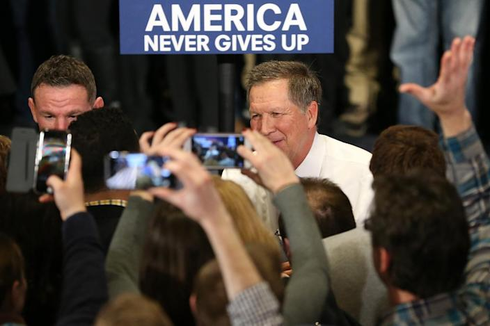 <p>Republican presidential candidate Ohio Gov. John Kasich meets supporters at a campaign gathering after taking second place in the New Hampshire Republican primary on Feb. 9, 2016, in Concord, N.H. Kasich lost to Donald Trump, although he upset fellow Republicans Gov. Chris Christie and former Gov. Jeb Bush. (Andrew Burton/Getty Images)</p>