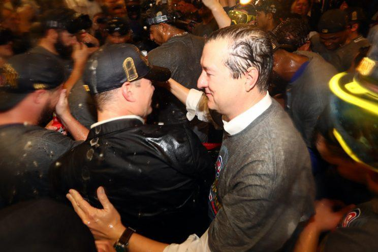 Theo Epstein and Cubs owner Tom Ricketts embrace after the Cubs won the World Series. (Getty Images)