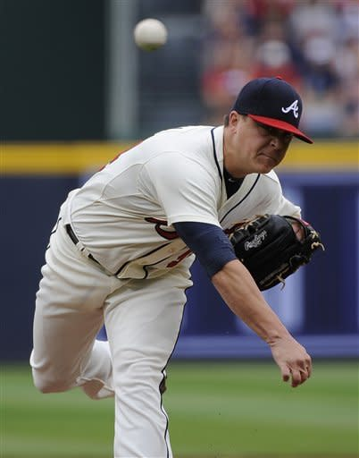 Atlanta Braves pitcher Kris Medlen delivers to the New York Mets during the first inning of their baseball game at Turner Field Sunday, Sept. 30, 2012, in Atlanta. (AP Photo/David Tulis)