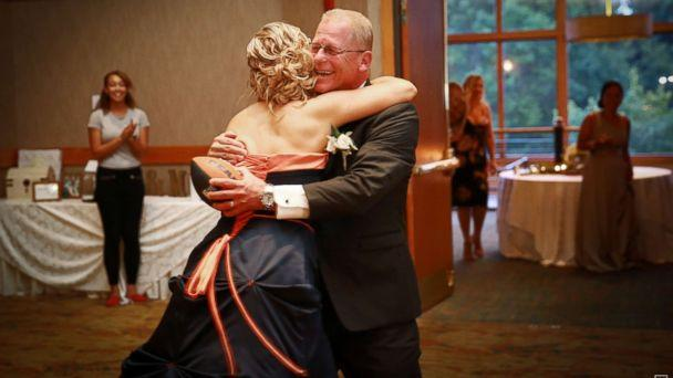 PHOTO: Brittney Harmon surprised her die-hard Chicago Bears fan father, Steve Benda, by wearing a team-themed dress at her wedding on July 22, 2017. (Fridge Thing Productions)