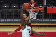 Rutgers center Cliff Omoruyi (5) misses a dunk with Indiana guard Khristian Lander defending during the second half of an NCAA college basketball game, Wednesday, Feb. 24, 2021, in Piscataway, N.J.(AP Photo/Kathy Willens)
