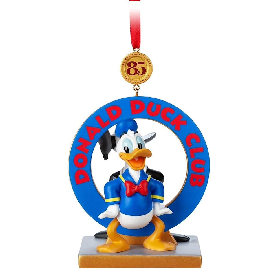 "<p>Celebrate 85 magical years of one of the most beloved Disney characters with this two-sided <a href=""https://www.popsugar.com/buy/Donald%20Duck%20Legacy%20Sketchbook%20Ornament-471175?p_name=Donald%20Duck%20Legacy%20Sketchbook%20Ornament&retailer=shopdisney.com&price=20&evar1=moms%3Aus&evar9=46410291&evar98=https%3A%2F%2Fwww.popsugar.com%2Ffamily%2Fphoto-gallery%2F46410291%2Fimage%2F46410364%2FDonald-Duck-Legacy-Sketchbook-Ornament&list1=holiday%2Cdisney%2Cchristmas%20ornaments&prop13=api&pdata=1"" rel=""nofollow"" data-shoppable-link=""1"" target=""_blank"" class=""ga-track"" data-ga-category=""Related"" data-ga-label=""https://www.shopdisney.com/donald-duck-legacy-sketchbook-ornament-limited-release-1520417?pagePath=%2Fcollections%2Fchristmas-in-july&amp;pageType=categoryPage&amp;algorithm=filter%3Afalse%2Csort%3AD-date&amp;position=2%2C224"" data-ga-action=""In-Line Links"">Donald Duck Legacy Sketchbook Ornament</a> ($20). The front features a colorful modern Donald, while the back sports a black-and-white old-school version of this spunky duck.</p>"