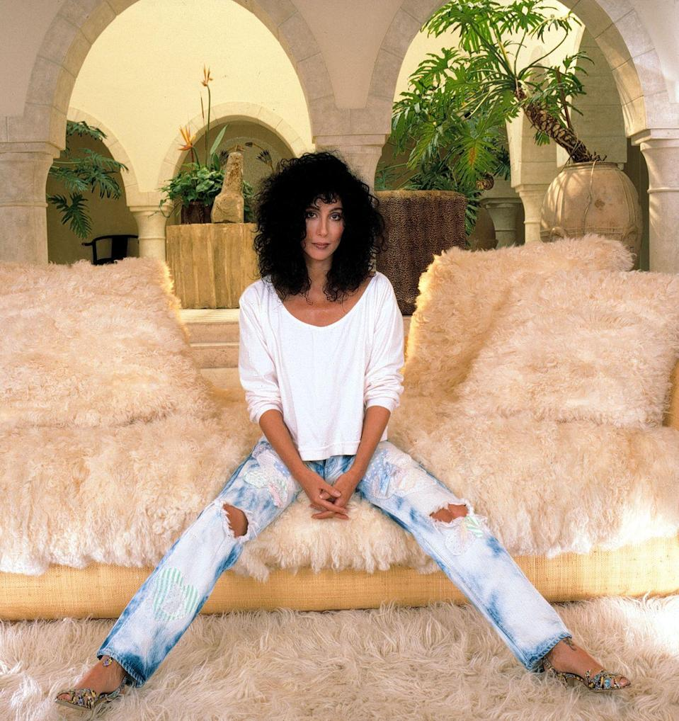 <p>Dressed down in acid wash jeans and a white top for a portrait session at home. </p>