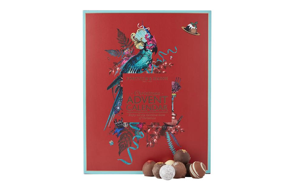 "<p>With a chocolate selection like no other, gorge the days of December away with this range of delights including flavours like passionfruit, gin and lime and pink marc de champagne. <br><a href=""https://www.fortnumandmason.com/products/fortnum-s-chocolate-selection-advent-calendar-300g?taxon_id=695"" rel=""nofollow noopener"" target=""_blank"" data-ylk=""slk:Fortnum & Mason, £35"" class=""link rapid-noclick-resp""><i>Fortnum & Mason, £35</i></a> </p>"