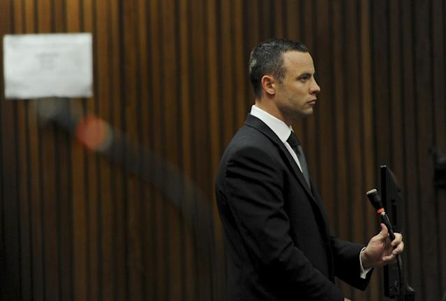 Oscar Pistorius stands in the dock at the high court in Pretoria, South Africa, Wednesday, May 14, 2014. The judge overseeing the murder trial of Pistorius on Wednesday ordered the double-amputee athlete to undergo psychiatric tests, meaning that the trial proceedings will be delayed. The court adjourned until May 21, 2014. (AP Photo/Werner Beukes, Pool)