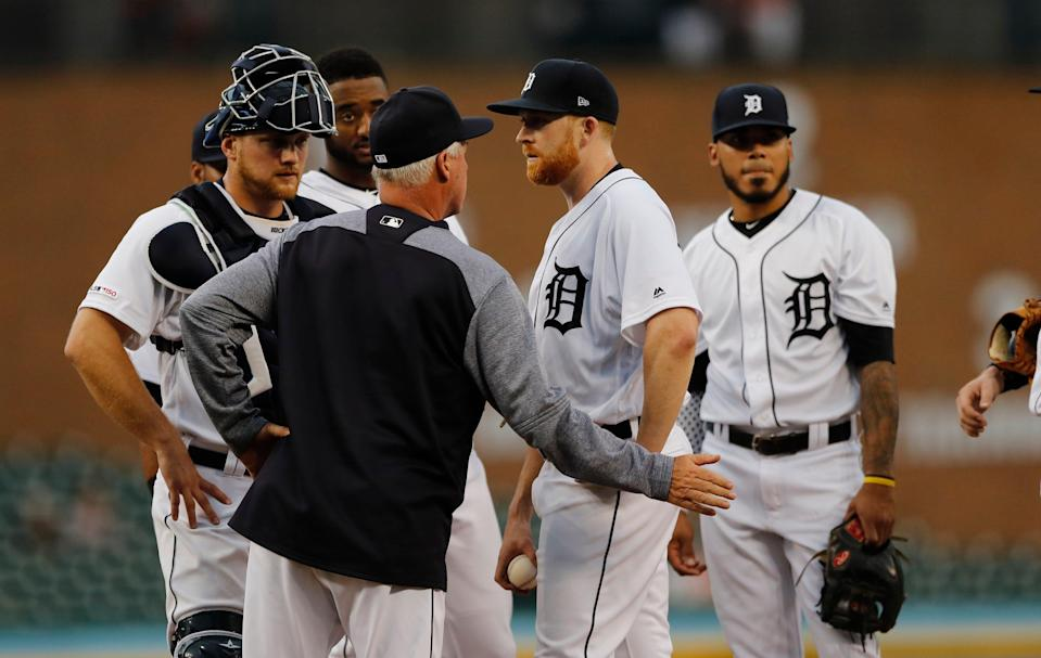 Detroit Tigers pitching coach Rick Anderson talks with pitcher Spencer Turnbull during the fifth inning against the Tampa Bay Rays, Wednesday, June 5, 2019, in Detroit.