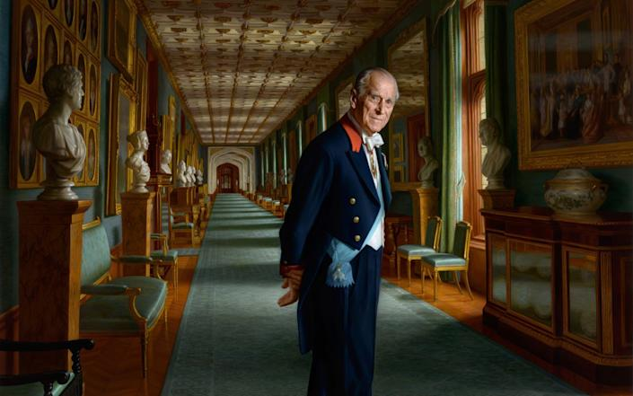 Pictured in The Grand Corridor at Windsor Castle in 2017, Prince Philip is wearing the sash of the Order of the Elephant, Denmark's highest-ranking honour - Getty Images