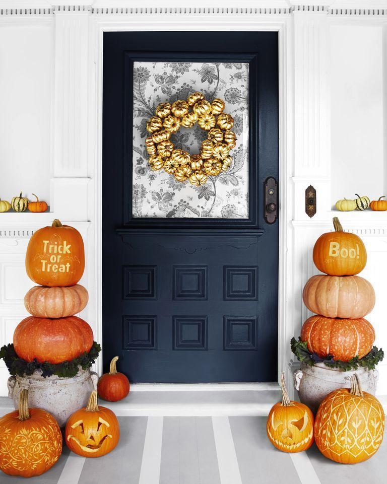 """<p>You don't have to make intricate carvings to create a cute pumpkin display. Wow visitors by piling heirloom pumpkins on top of a stylish planter. </p><p><strong>RELATED:</strong> <a href=""""https://www.goodhousekeeping.com/holidays/halloween-ideas/g1714/no-carve-pumpkin-decorating/"""" rel=""""nofollow noopener"""" target=""""_blank"""" data-ylk=""""slk:No-Carve Pumpkin Decorating Ideas to Fill Your Halloween With Fun"""" class=""""link rapid-noclick-resp"""">No-Carve Pumpkin Decorating Ideas to Fill Your Halloween With Fun</a></p>"""