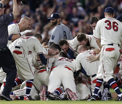 The Atlanta Braves celebrate after B.J. Upton's game-winning hit in the 10th inning of a baseball game against the Washington Nationals in Atlanta, Saturday, June 1, 2013. Atlanta won 3-2. (AP Photo/John Bazemore)