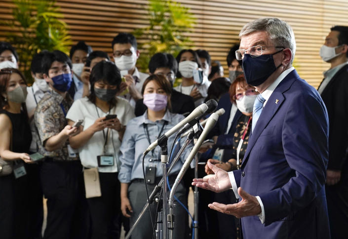 International Olympic Committee President Thomas Bach, right, speaks to journalists after meeting Japanese Prime Minister Yoshihide Suga at the prime minister's official residence in Tokyo, Japan, Wednesday, July 14, 2021.(Kimimasa Mayama/Pool Photo via AP)