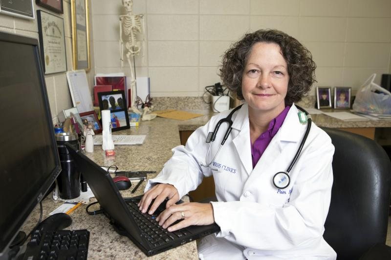 Dr. Pamela Banister poses while working at a clinic which is part of the Singing River Health System in Pascagoula, Mississippi