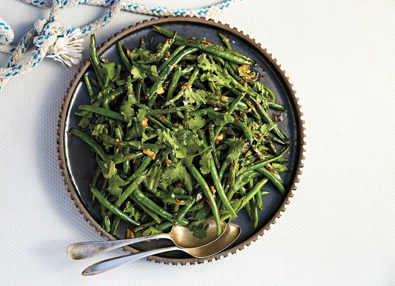"""Don't rush to shake the pan and toss the green beans before they blister; they need a little time to char. <a href=""""https://www.bonappetit.com/recipe/blistered-green-beans-with-garlic-and-miso?mbid=synd_yahoo_rss"""">See recipe.</a>"""