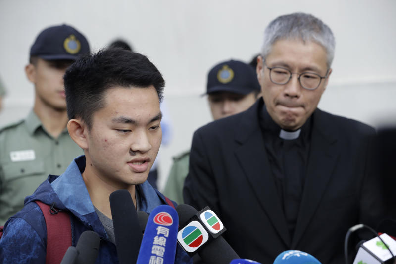 Chan Tong-kai, left, talks to the media as he is released from prison in Hong Kong Wednesday, Oct. 23, 2019. Chan, who's wanted for killing his girlfriend last year on the self-ruled island, had asked the Hong Kong government for help turning himself in to Taiwan after his sentence for money laundering offenses ends on Wednesday. (AP Photo/Mark Schiefelbein)