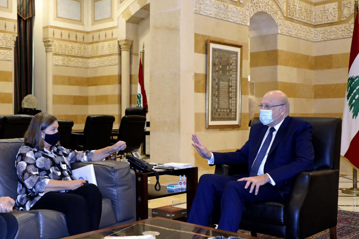 In this photo released by the Lebanese government, Lebanese Prime Minister Najib Mikati, right, meets with US Under Secretary of State for Political Affairs Victoria Nuland at the Government House in downtown Beirut, Lebanon, Thursday, Oct. 14, 2021. (Dalati Nohra/Lebanese Official Government via AP)