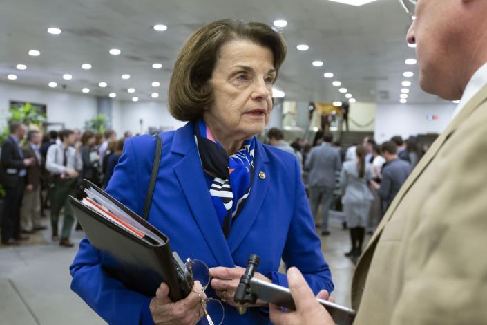 Sen. Dianne Feinstein, D-Calif., talks to reporters as she walks to her office during the impeachment trial of President Donald Trump on charges of abuse of power and obstruction of Congress, on Capitol Hill in Washington, Monday, Feb. 3, 2020. (AP Photo/Jose Luis Magana)