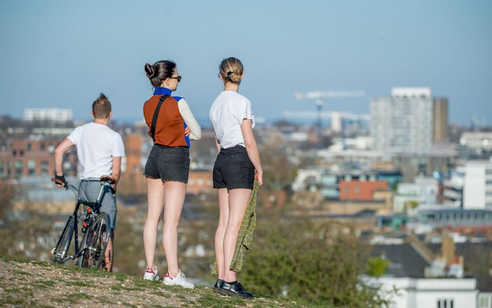 Members of the public enjoy the day's warm weather on Primrose Hill on April 5, 2020 in London - Ollie Millington/Getty Images