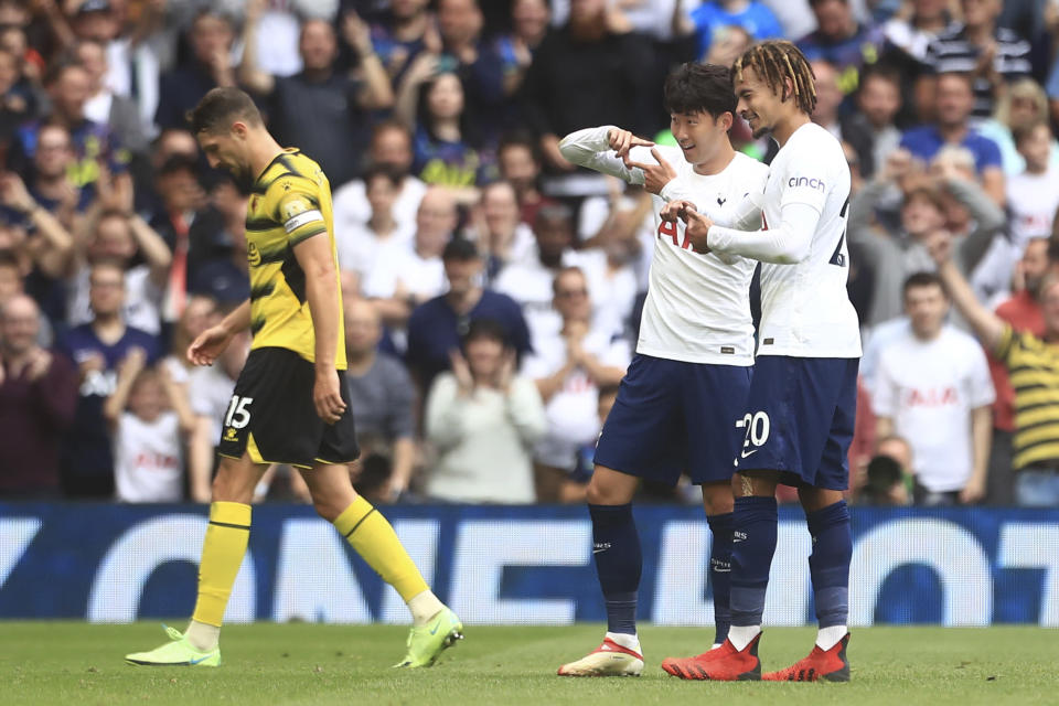 Tottenham's Son Heung-min, center, celebrates after scoring his side's opening goal during the English Premier League match between Tottenham Hotspur and Watford at the Tottenham Hotspur Stadium in London, Sunday, Aug. 29, 2021. (AP Photo/Leila Coker)