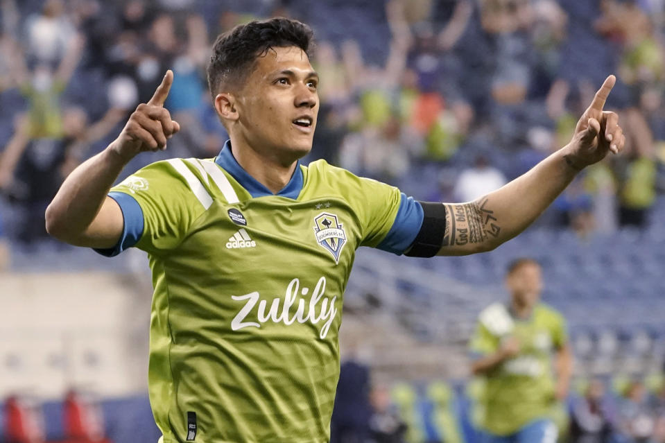 Seattle Sounders forward Fredy Montero celebrates after scoring a goal against Minnesota United during the second half of an MLS soccer match Friday, April 16, 2021, in Seattle. The Sounders won 4-0. (AP Photo/Ted S. Warren)
