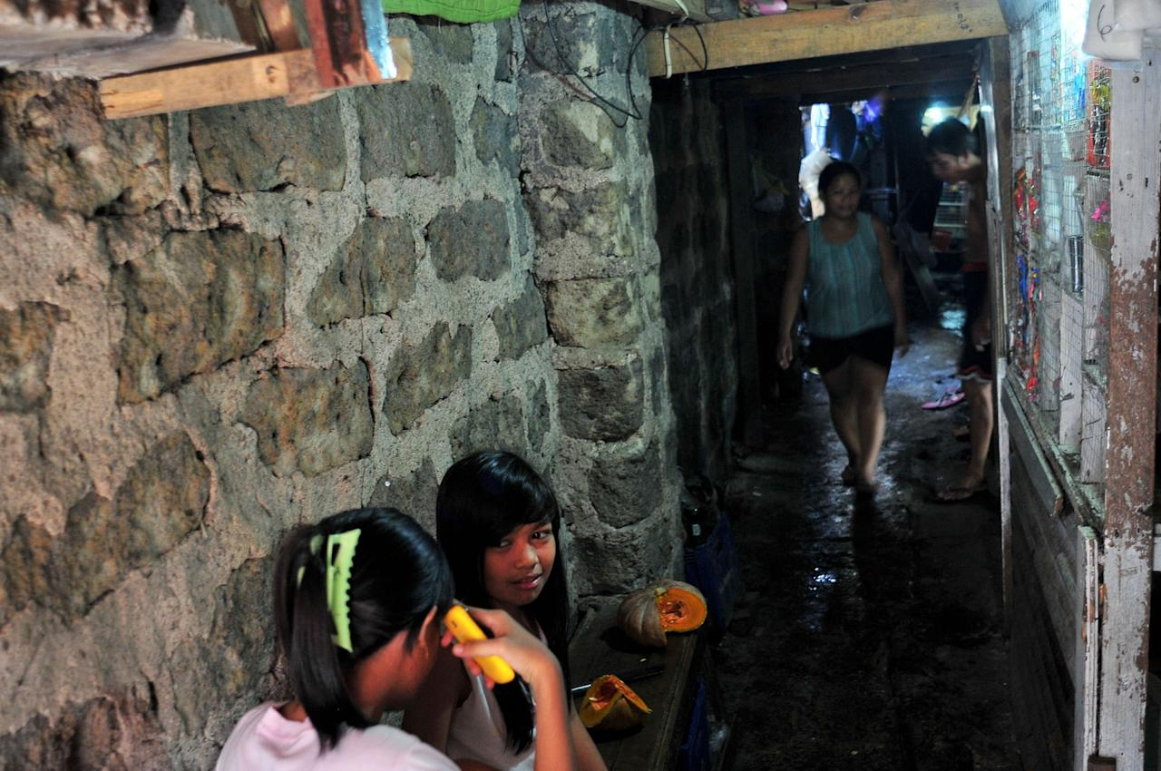 MANILA, PHILIPPINES - JUNE 11: Residents are seen living in a tunnel-like environment along the creek in P. Casal district on June 9, 2013 in Manila, Philippines. It has been reported that 105,000 of 580,000 informal settlers in Manila have set up home in disaster prone areas. Recent reports have named the Philippines as Asia's fastest growing economy, however the housing shortage is still a major concern for many of Manila's poorest communities. (Photo by Veejay Villafranca/Getty Images)