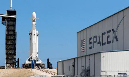 A SpaceX Falcon Heavy rocket with the Arabsat 6A communications satellite aboard is prepared for launch later in the day at the Kennedy Space Center in Cape Canaveral