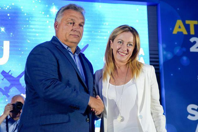 ISOLA TIBERINA, ROME, ITALY - 2019/09/21: Giorgia Meloni greets the Hungarian Prime Minister Viktor Orban, who spoke during the Atreju 2019, the annual meeting of the right-wing political party Fratelli d'Italia in Rome. (Photo by Vincenzo Nuzzolese/SOPA Images/LightRocket via Getty Images) (Photo: SOPA Images SOPA Images/LightRocket via Gett)
