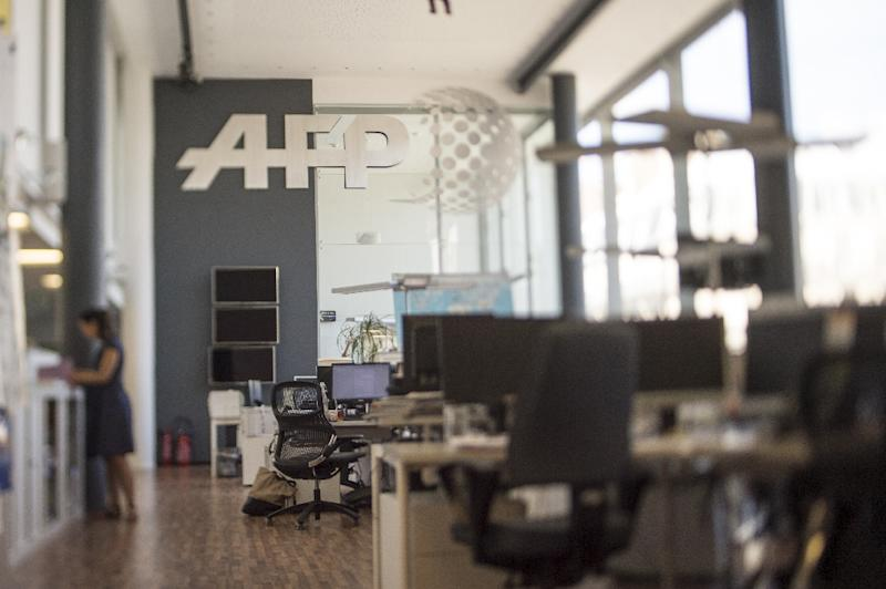 """AFP's global news director Michele Leridon said media rivalry needed to be put to one side, because """"The core values of our profession are under attack,"""" she said"""