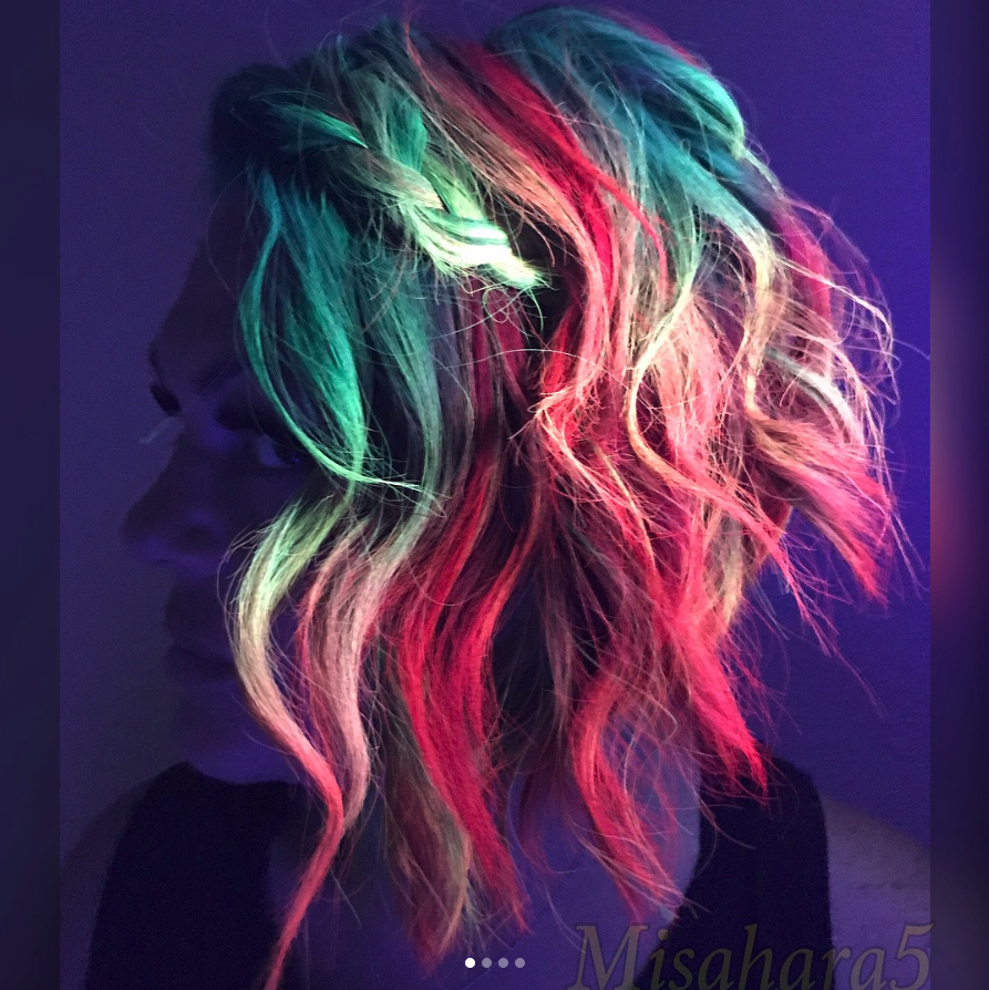 """<p>With festival season approaching, Mykey O'Halloran says that neon glow-in-the-dark hair is something you''l probably see a lot of on Instagram this year, as it allows you to take extreme color to a whole new level.<br><a href=""""http://www.cosmopolitan.com/style-beauty/beauty/a8262626/glow-in-the-dark-hair-color/"""" rel=""""nofollow noopener"""" target=""""_blank"""" data-ylk=""""slk:Cosmopolitan"""" class=""""link rapid-noclick-resp""""><em>Cosmopolitan</em></a> reports that this trend emerged somewhere back in 2016, but new and improved shades this year will surely make it more engaging. Instead of basic pastels, O'Halloran says, we'll see bright colors like electric tiger lily orange, electric lizard green, and electric banana yellow take center stage. And while these electrifying tones are usually visible under neon light, you'll want to think of it more as a fashion accessory that will help your festival outfit pop.<br>""""The best part about these colours is that when you're on the dance floor, you get the amazing effect of glowing under black light,"""" O'Halloran tells Yahoo Lifestyle. (Photo: Instagram/misahara5) </p>"""