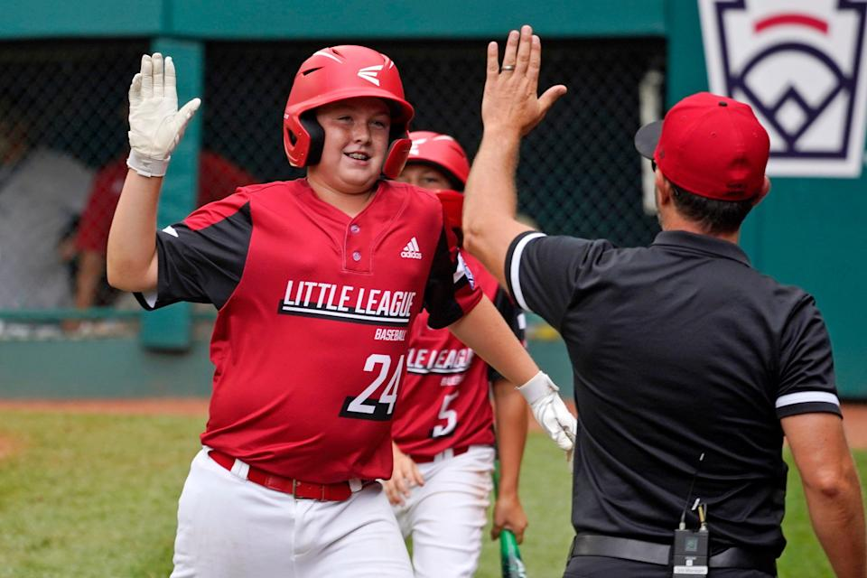 Hamilton, Ohio's Cooper Oden (24) celebrates after scoring during the second inning.