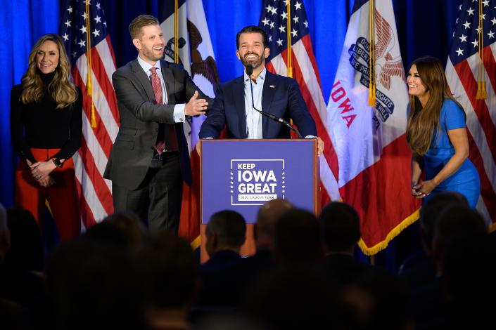 "Donald Trump Jr. (C) speaks with his brother Eric (2nd L) and wife Lara, as well as his girlfriend Kimberly Guilfoyle (R) during a ""Keep Iowa Great"" press conference in Des Moines, IA, on February 3, 2020. (Jim Watson/AFP via Getty Images)"
