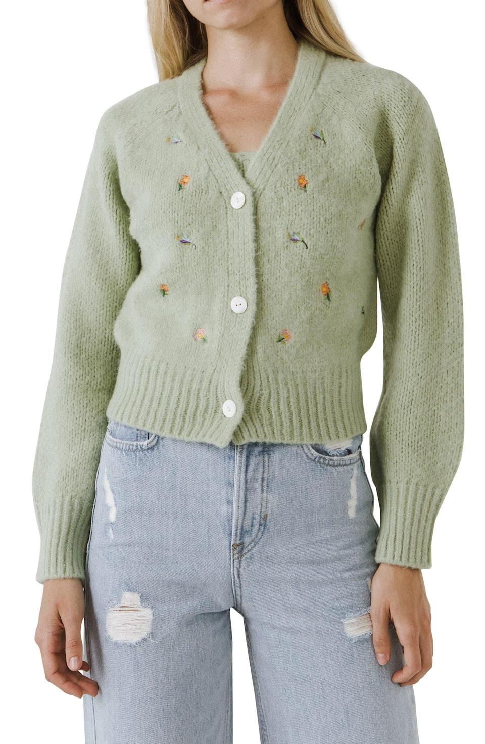 <p>The little blossoms on this <span>English Factory Embroidered Cardigan</span> ($70) make it especially charming, while the cropped fit makes it cool and modern.</p>