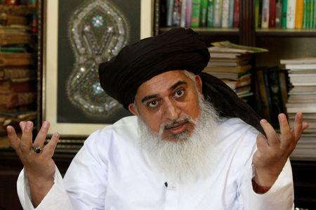 FILE PHOTO: Khadim Hussain Rizvi, leader of Tehrik-e-Labaik Pakistan Islamist political party gestures during an interview with Reuters in Lahore
