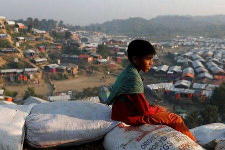 FILE PHOTO: A Rohingya refugee child looks at the vill from a hill at Unchiparang refugee camp, near Cox's Bazar, Bangladesh January 11, 2018. REUTERS/Tyrone Siu