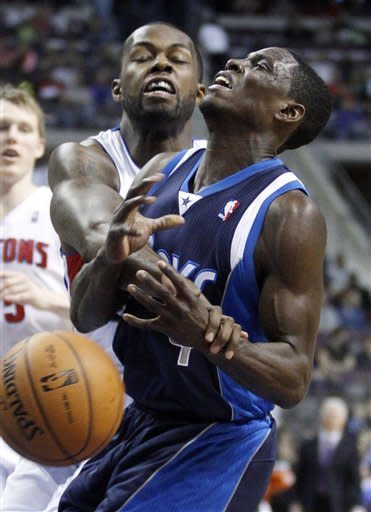 Detroit Pistons guard Rodney Stuckey, left, fouls Dallas Mavericks guard Darren Collison while trying to knock away the ball during the first half of an NBA basketball game Friday, March 8, 2013, in Auburn Hills, Mich. (AP Photo/Duane Burleson)