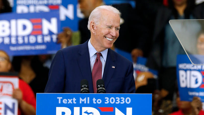 Former Vice President Joe Biden gestures as he speaks during a campaign rally at Renaissance High School in Detroit, Michigan on March 9, 2020. (Jeff Kowalsky/AFP via Getty Images)