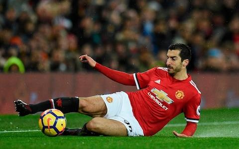 Henrikh Mkhitaryan slides for the ball - Credit: AFP