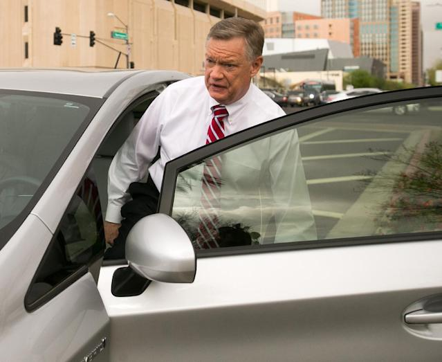 FILE - Former Fiesta Bowl executive director John Junker gets into his car outside the Sandra Day O'Connor U.S. courthouse after being sentenced in Phoenix on in this March 13, 2014 file photo. The sentencing Thursday March 20, 2014 of 58-year-old John Junker in Maricopa County Superior Court will mark the end of criminal cases that arose from the contribution scandal that jeopardized the bowl's NCAA license and led to the ouster of the longtime bowl leader. (AP Photo/The Arizona Republic, Michael Schennum, File)
