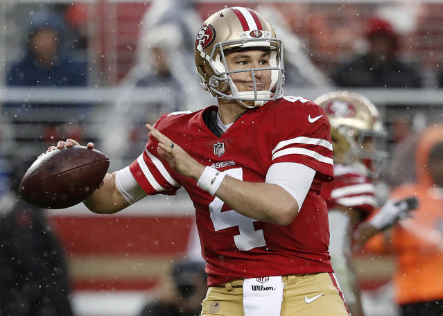 San Francisco 49ers quarterback Nick Mullens (4) passes against the Seattle Seahawks during the second half of an NFL football game in Santa Clara, Calif., Sunday, Dec. 16, 2018. (AP Photo/Tony Avelar)