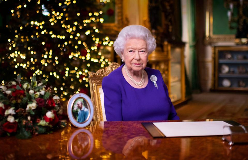 In this undated photo issued on Friday Dec. 25, 2020, Britain's Queen Elizabeth II records her annual Christmas broadcast in Windsor Castle, Windsor, England.