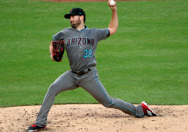 "<a class=""link rapid-noclick-resp"" href=""/mlb/players/9691/"" data-ylk=""slk:Robbie Ray"">Robbie Ray</a> has been a right answer thus far (AP)"