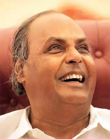 Dhirubhai Ambani was one of the sons of a village school teacher, belonging to the Modh community, born in Chorwad Gujarat. His first step towards entrepreneurship was when he started selling <em>chaat-pakoda</em> to pilgrims at Mount Girnar in Gujarat. At the age of 17 in 1955, he made his first overseas trip to Aden in Yemen as he left his home to join his brother, Ramniklal. While in Aden, his first job was that of a gas station-attendant.