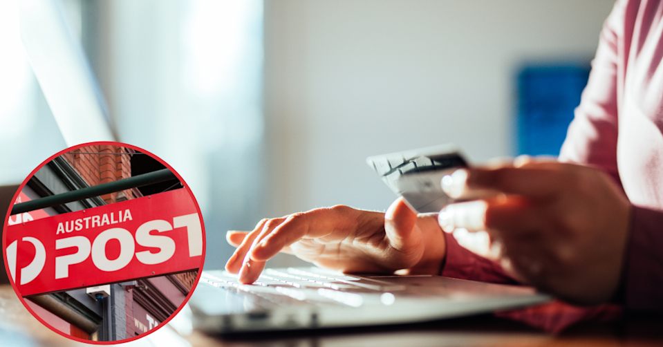 Australia Post sign. Woman using her laptop and holding a credit card.